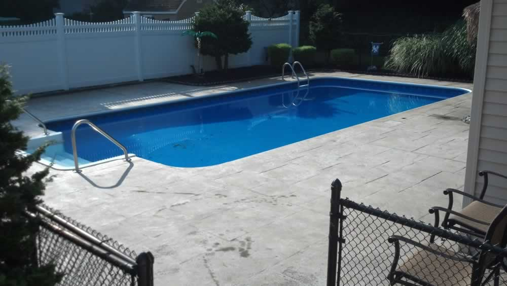 Stained Concrete Pool Deck Before