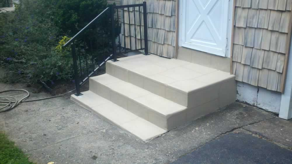 Orange Steps Amp New Railings After Trowled Ivory Liquid Stone Finishes