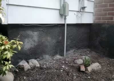 Foundation Wall After Troweled Concrete Overlay